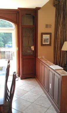 Custom Made Cabinets Around Sliding Door