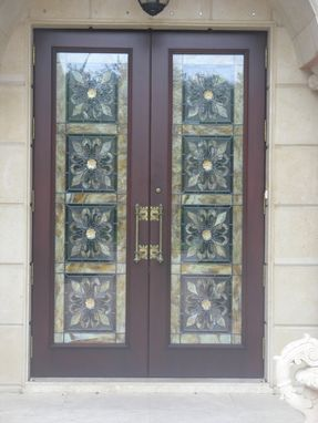 Custom Made Entry Doors With Custom Stained Glass Panels Behind Hurricane Impact Glass