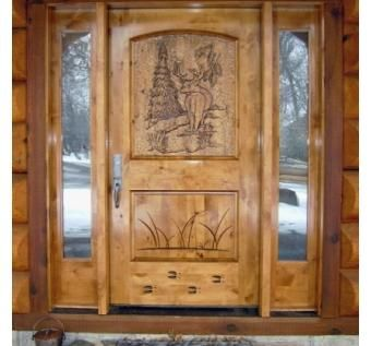 Handmade Custom Entry With Hand Carved Door Featuring A