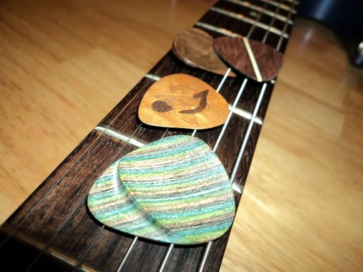Custom Made Wooden Guitar Picks With Hand-Shaped Thumb Grip