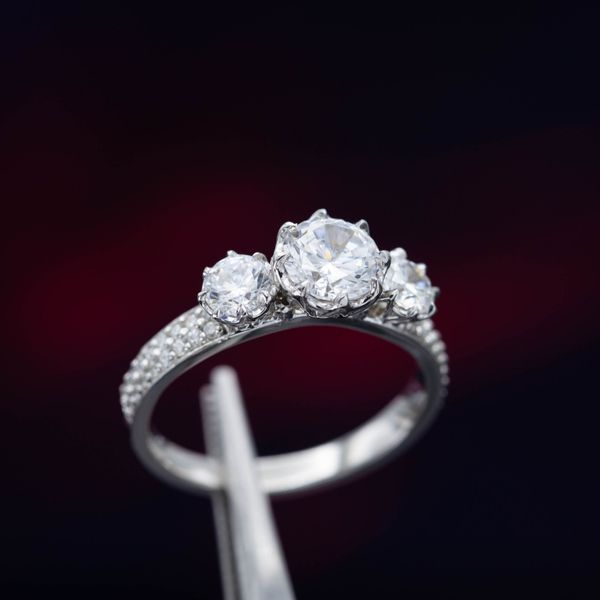 A three-stone CZ ring looks pretty and quite sparkly, but the center stones will dull with time and need to be replaced.