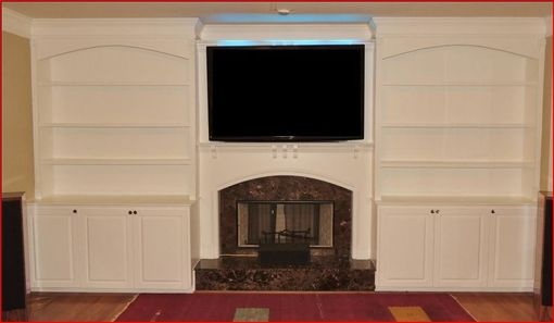 Custom Made Arched Top Bookshelves With Raised Panel Doors And Led Lighting