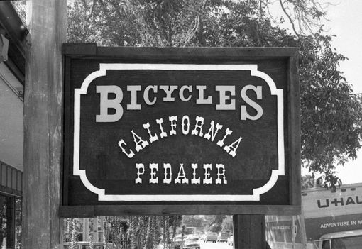 Custom Made Hand-Carved Sign For Bicycle Shop
