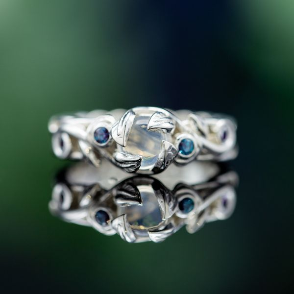 The nature theme in this ring extends even to the petal prongs that hold the moonstone in place.