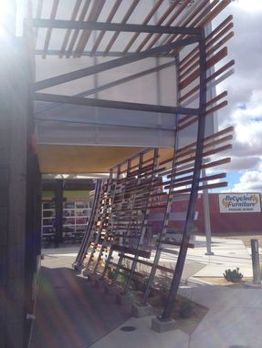Custom Made Vertical Steel Trellis With Wood On Store Front