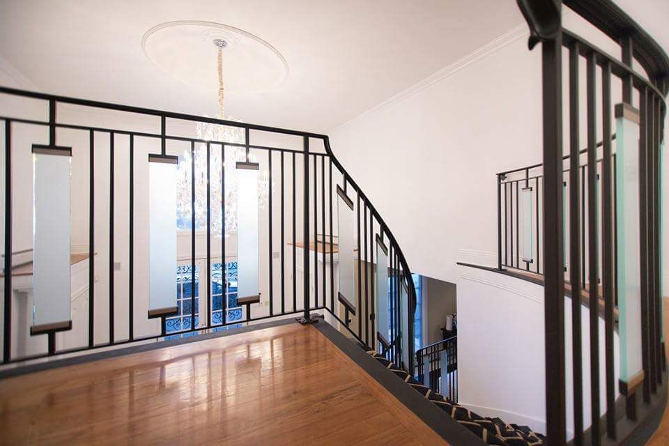 Hand made contemporary wrought iron interior railing with for Interior glass railing designs