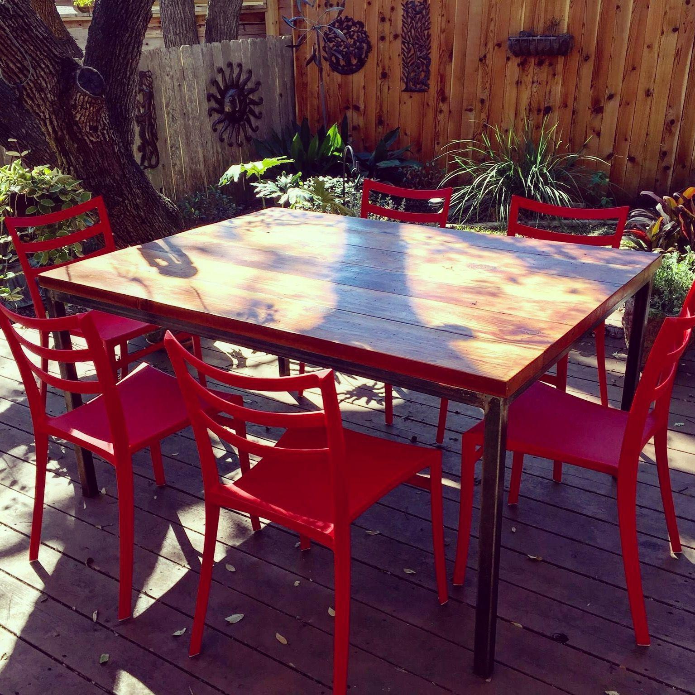 Custom made simple rustic steel reclaimed wood table