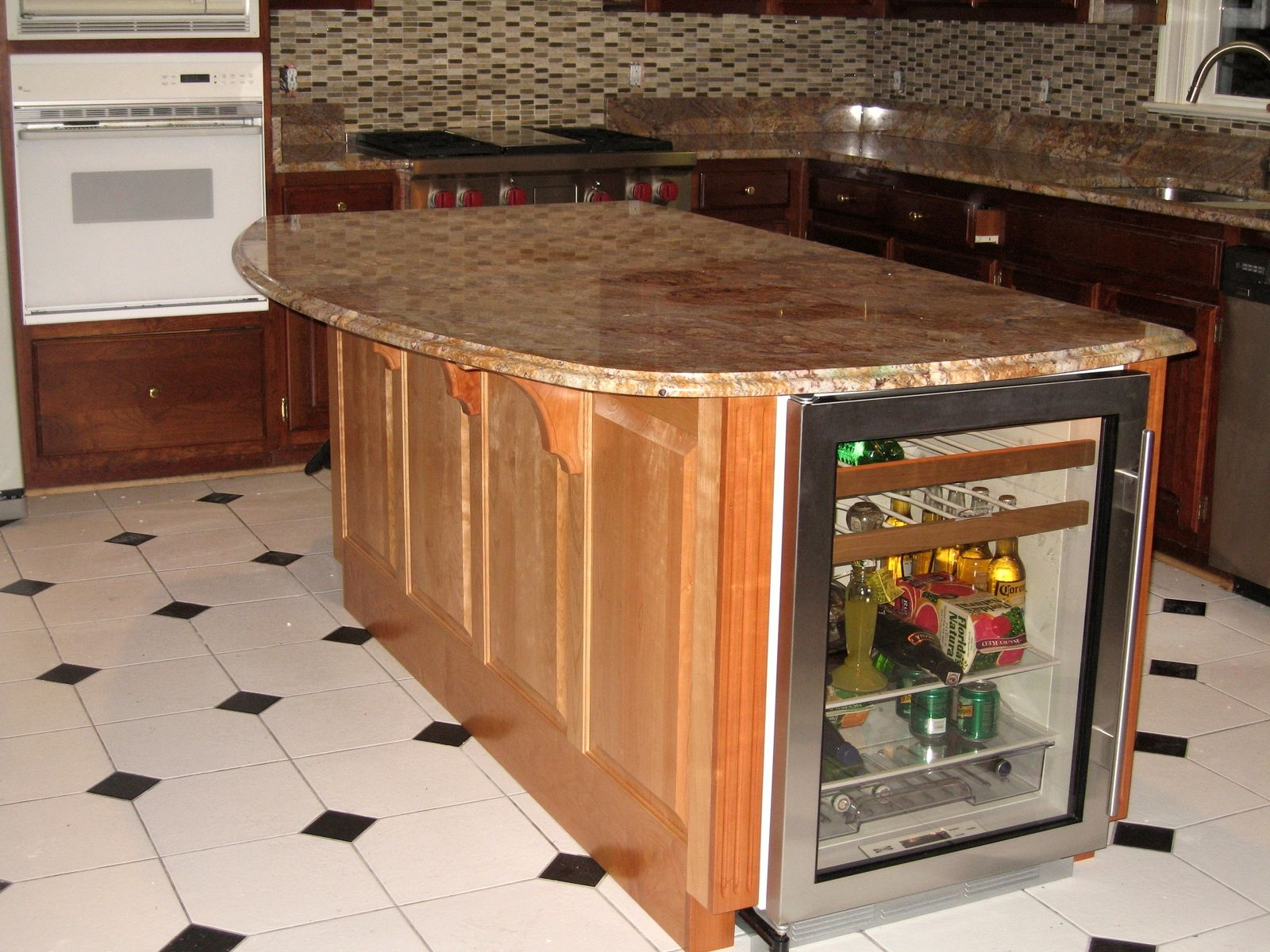 handmade kitchen island with winecooler and granite countertop