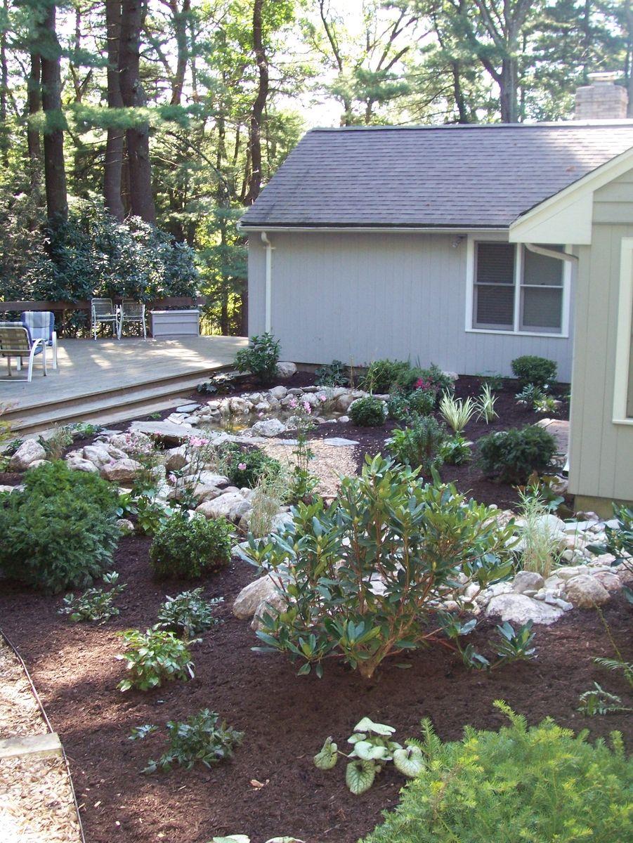 custom backyard stream and stone bridge by a yard u0026 a half outdoor