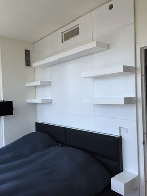 Custom Made Wall Unit With Custom Paneling And Floating Shelves