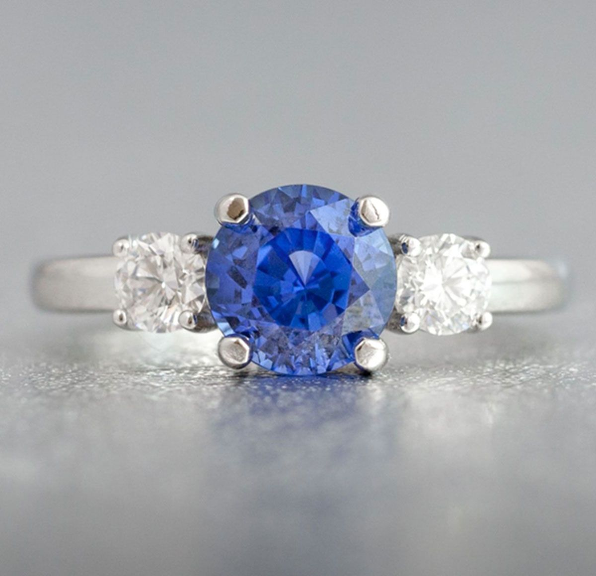 Michael's Engagement Ring A Natural, Unheated Sapphire Is The Eyecatching  Center Stone For This White Gold Threestone Setting