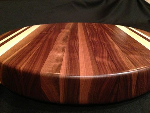 Custom Made Round Black Walnut Cutting Board With Rock Maple Accent Stripes