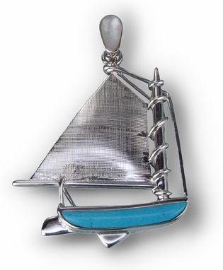 Custom Made Silver Catboat Inlaid With Turquoise