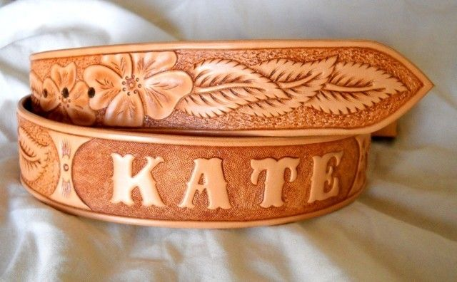 Hand made custom tooled leather belt by lone tree