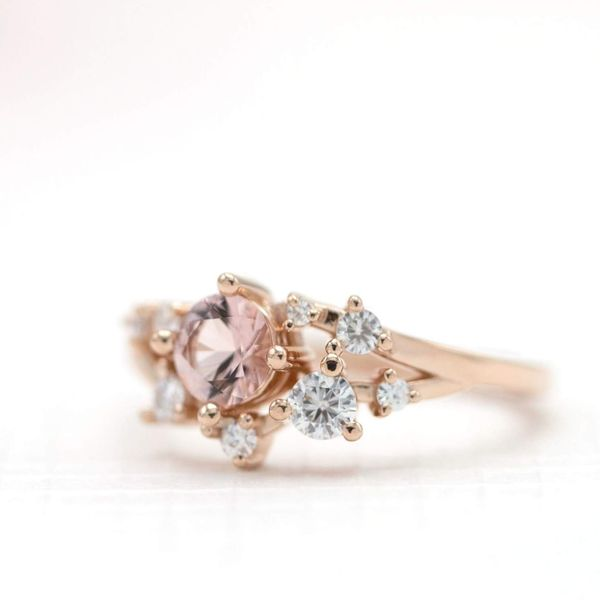 This delicate cluster ring combines morganite and diamonds in an open, modern, sparkly setting.