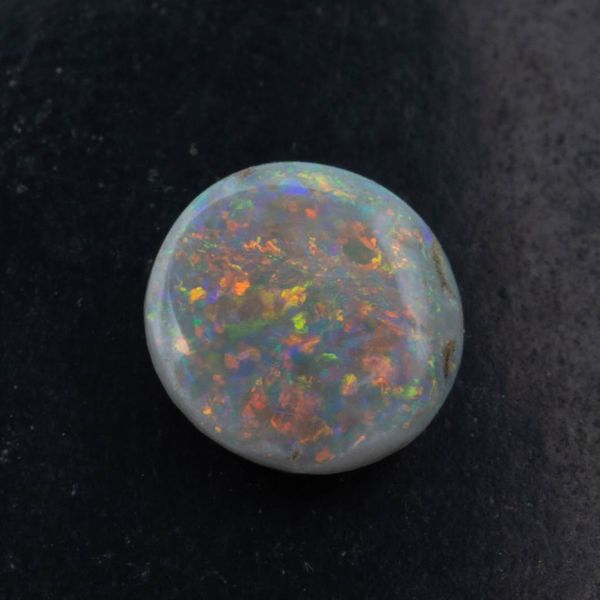 Dark opal with multi-colored flash.