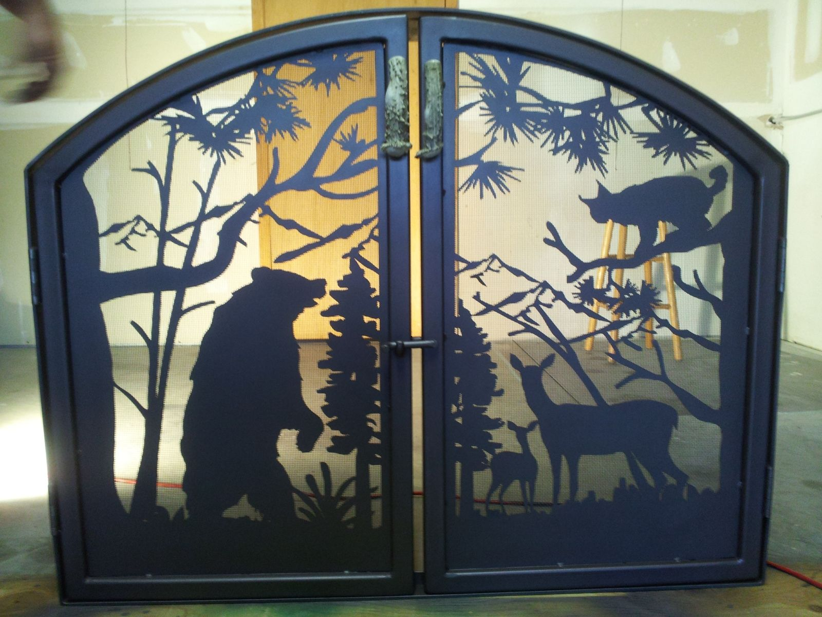 1200 #948237 Custom Made Arched Fireplace With Elk Antler Handles save image Custom Made Steel Doors 46671600