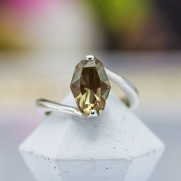 A modern sunstone ring set with a minimal white gold setting showcasing the unique center stone.