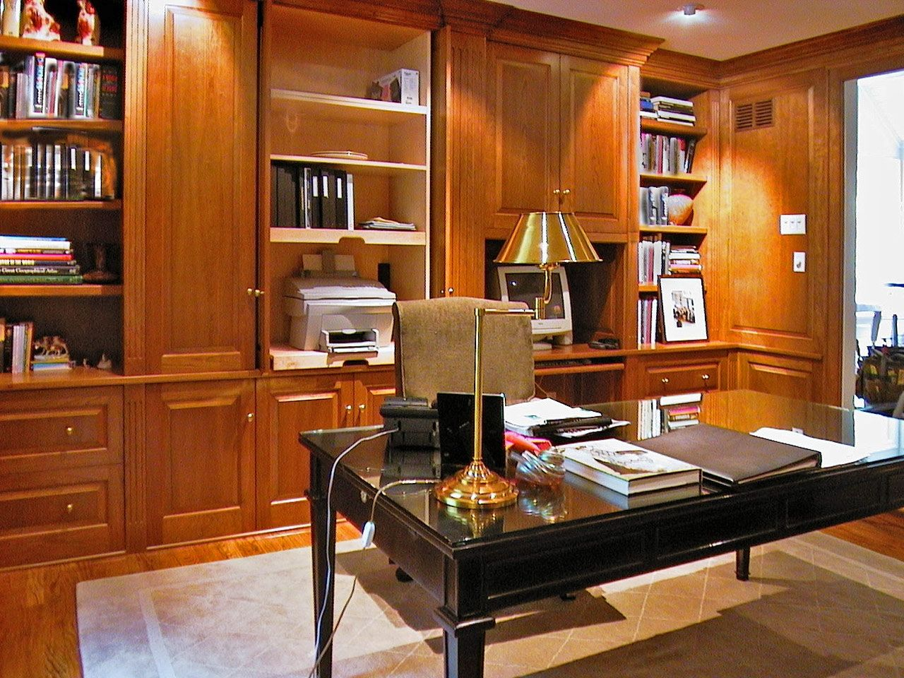 office paneling. custom made large paneled office in cherry paneling