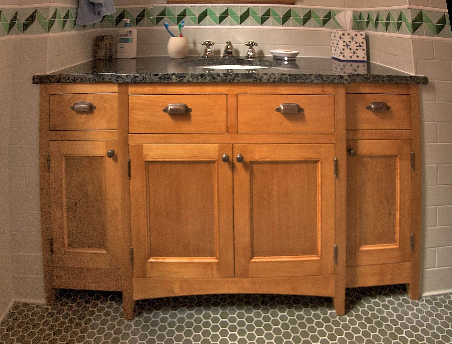 Custom maple bathroom cabinetry by mann designs for Bathroom cabinets natural wood