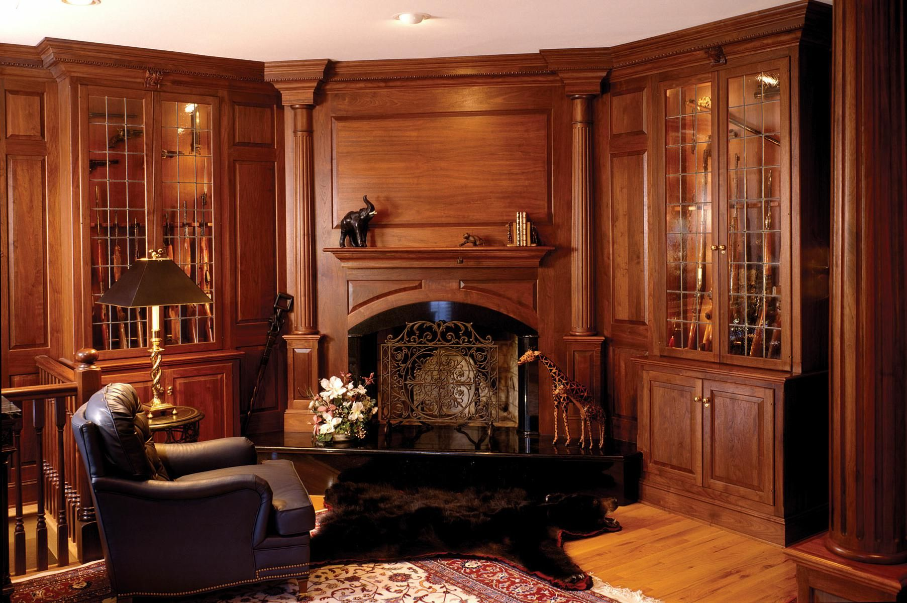 Handmade walnut library with fireplace and gun cabinets by for Traditional home decor