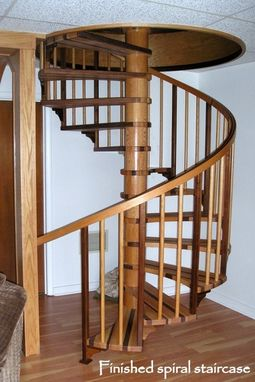 Custom Made Walnut And Red Oak Spiral Staircase.