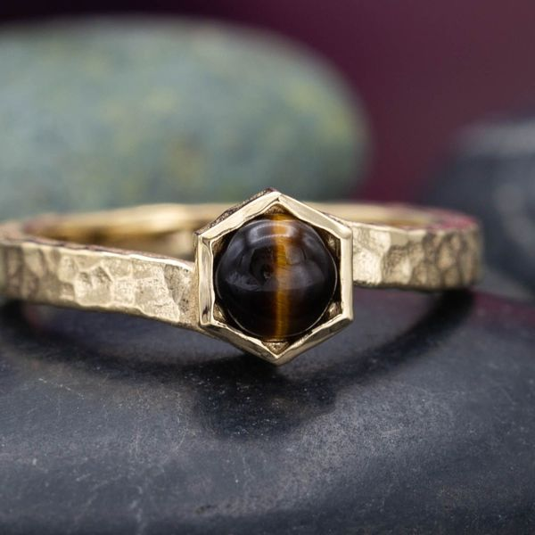 This classic Tiger's eye features the familiar line of the cat's eye across its surface.