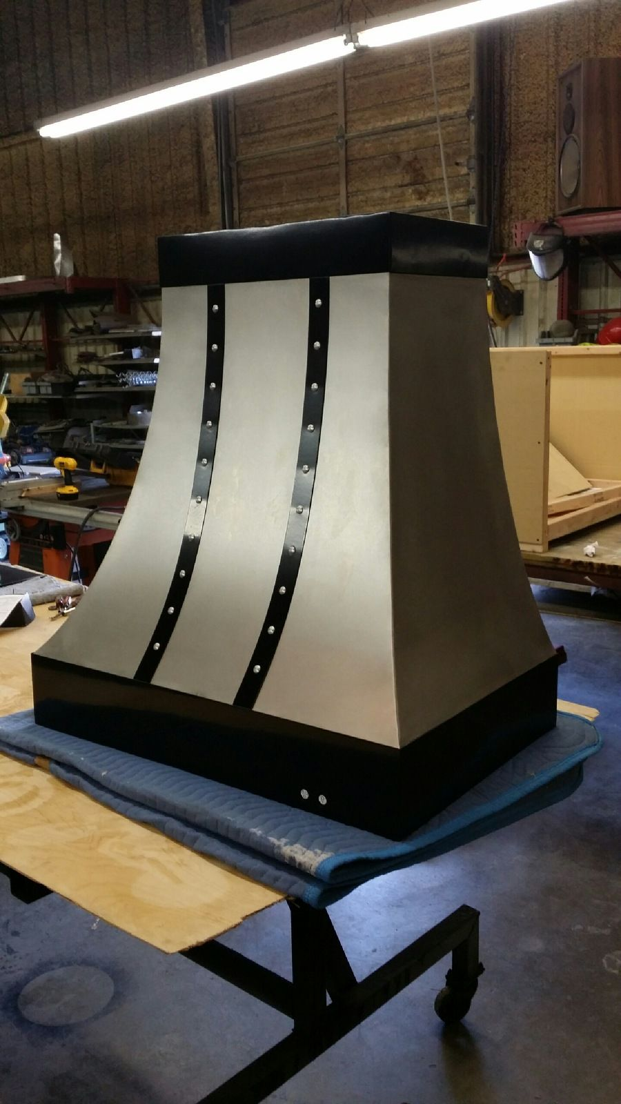 buy a hand made stainless steel and black strap range hood  made to order from fast lane