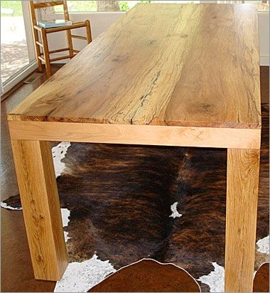 hand crafted pecan dining tablewhere wood meets steel