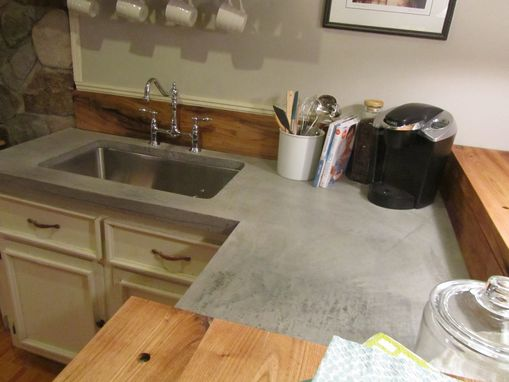 Custom Made Concrete Counter With White Walnut Counter