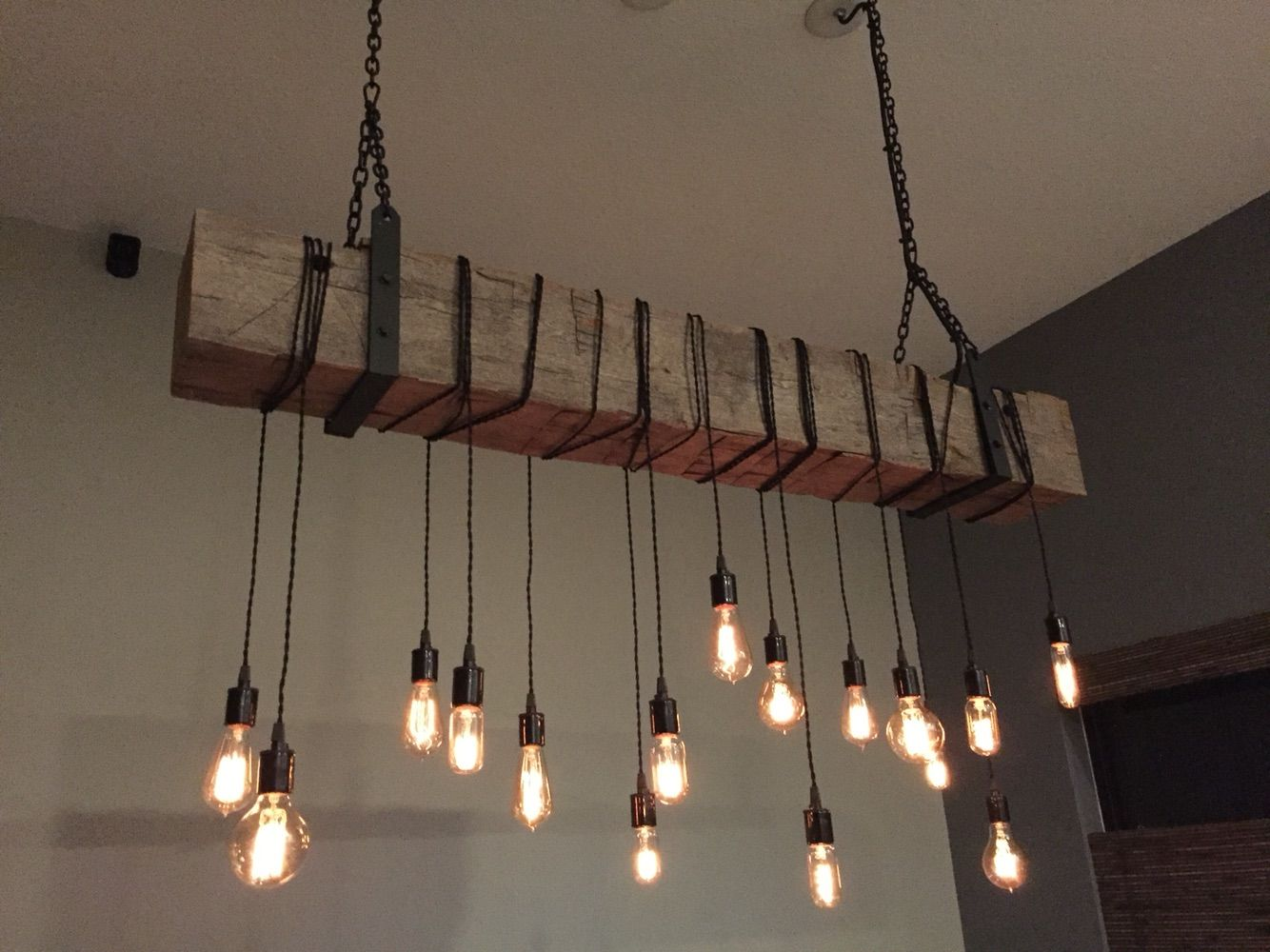 Custom made reclaimed barn beam chandelier light fixture modern industrial rustic restaurant bar