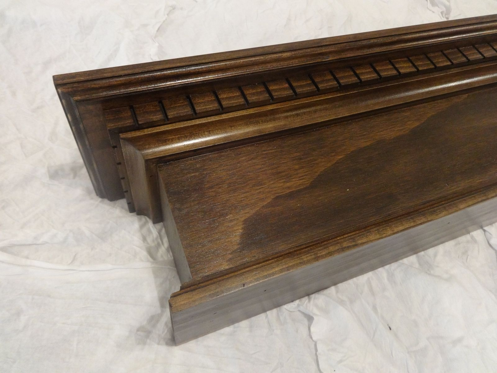 handmade expresso stained fireplace mantel with dentil molding by
