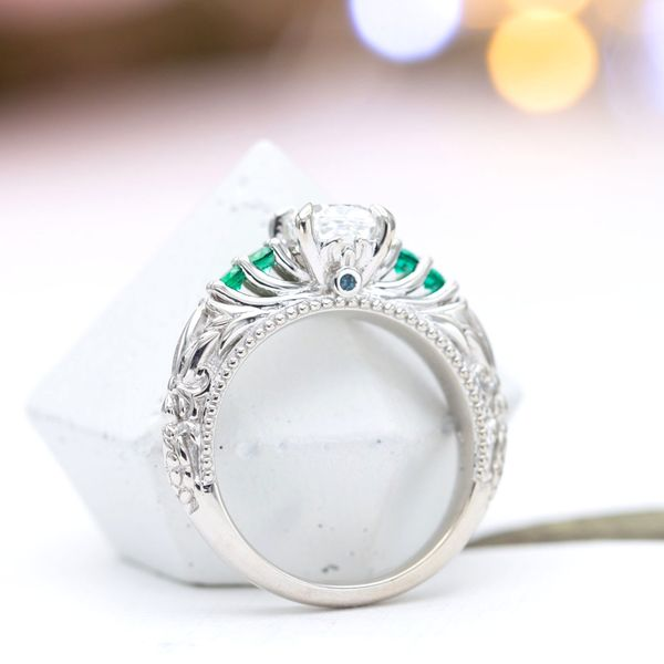 This ring's side profile reveals bead detailing and peek-a-boo gem settings.
