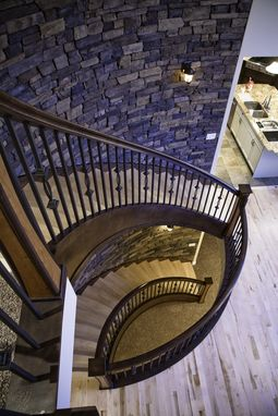 Custom Made Tri-Story Curved Staircase