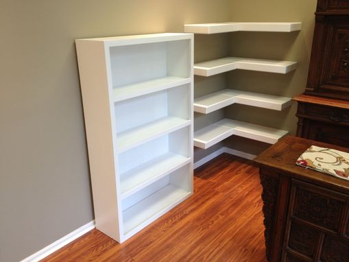 Custom Made 12 Floating Shelves And 3 Floor Standing Units.