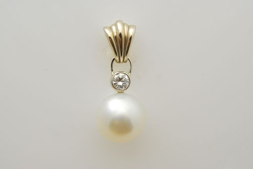Custom Made 14kt White Gold With A 11mm Pearl And A .25ct Diamond Set In A 14kt White Gold Bezel