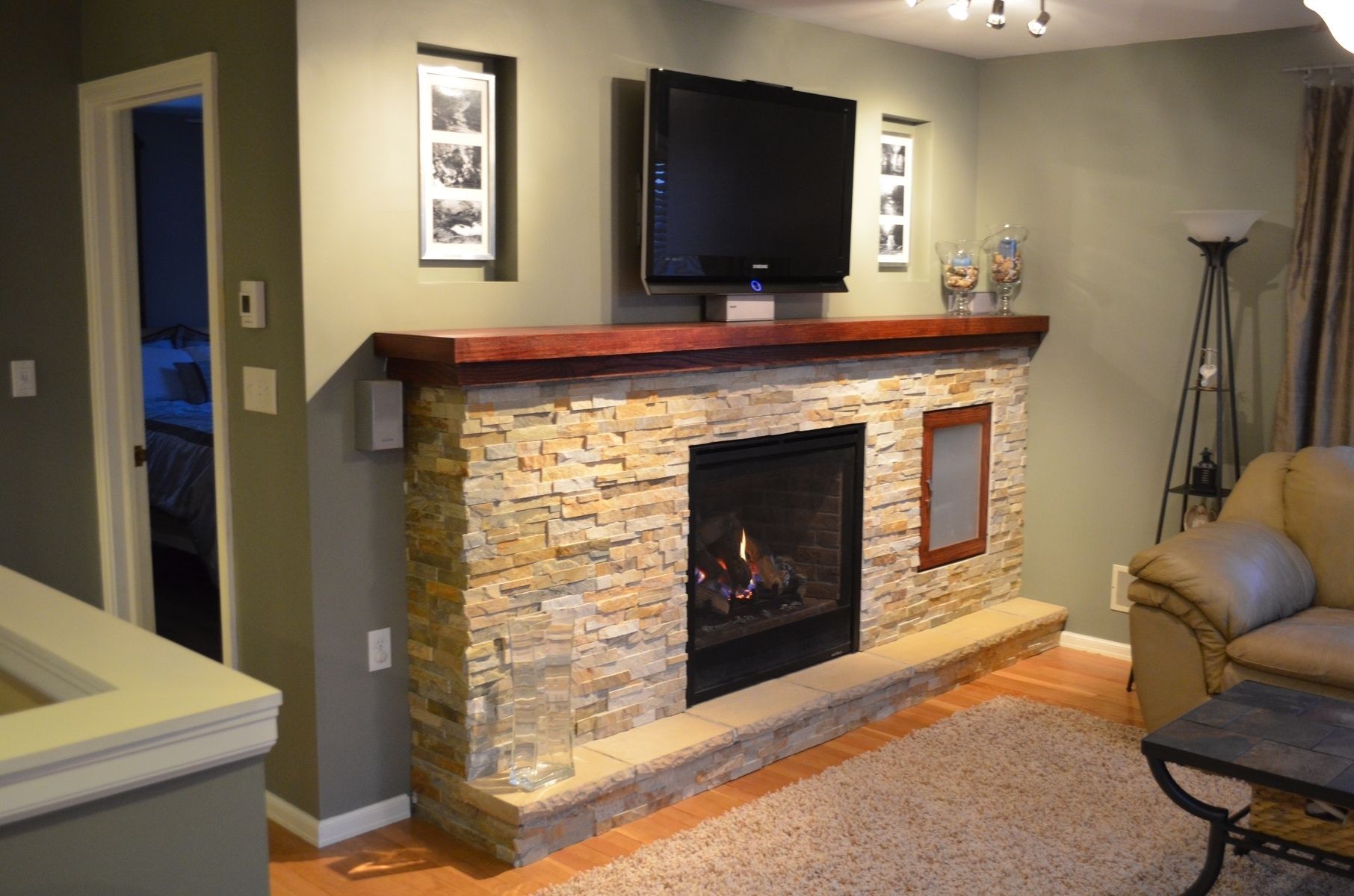 I designed and built this custom fireplace with entertainment center.  There are custom nooks for pictures above the mantel along with built in media …