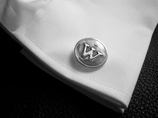 Custom Made Silver Cufflinks With Family Logo