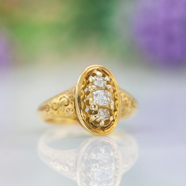 A beautiful antique ring, dating to the late 1800s. The diamonds in this ring appear to be original Old Mine cuts typical of that era.