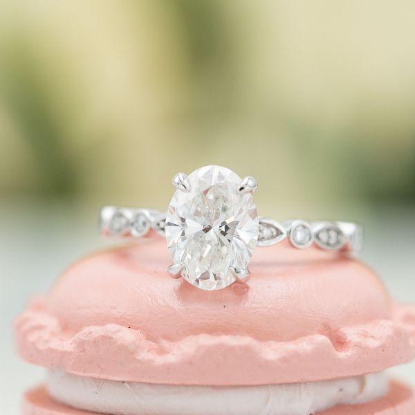 Oval cut diamond with faint fluorescence.