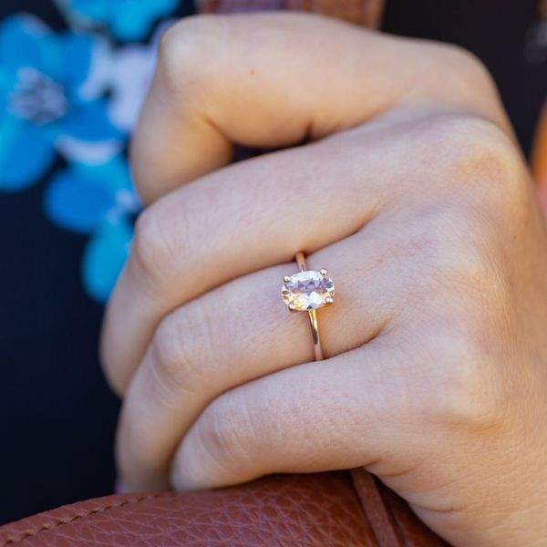 A classic, minimal solitaire morganite engagement ring is a showcase for the center stone.