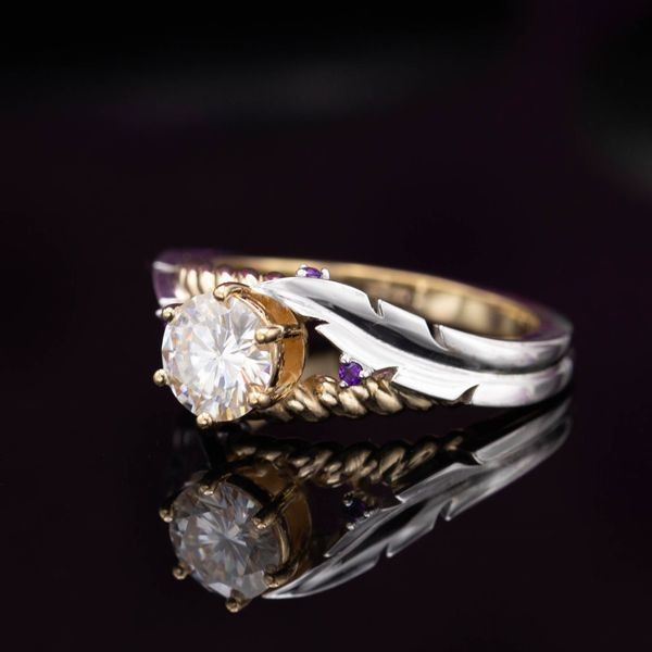 Round brilliant moissanite. White gold feather and rose gold rope details intertwine with amethyst accents.