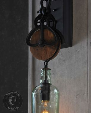 Custom Made Wooden Pulley Wheel Wall Sconce With Recycled Gin Bottle Fixture
