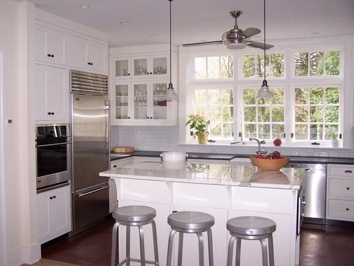 Custom Made White And Silver Kitchen