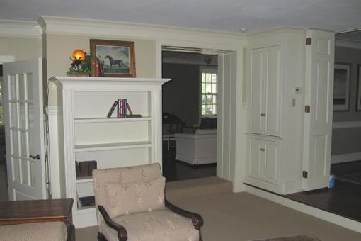 Custom Made Painted Bookcases And Fireplace