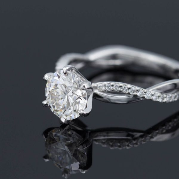 1.17 carat round, lab-created diamond in 6 prong setting with vining 18k white gold, diamond pave band.