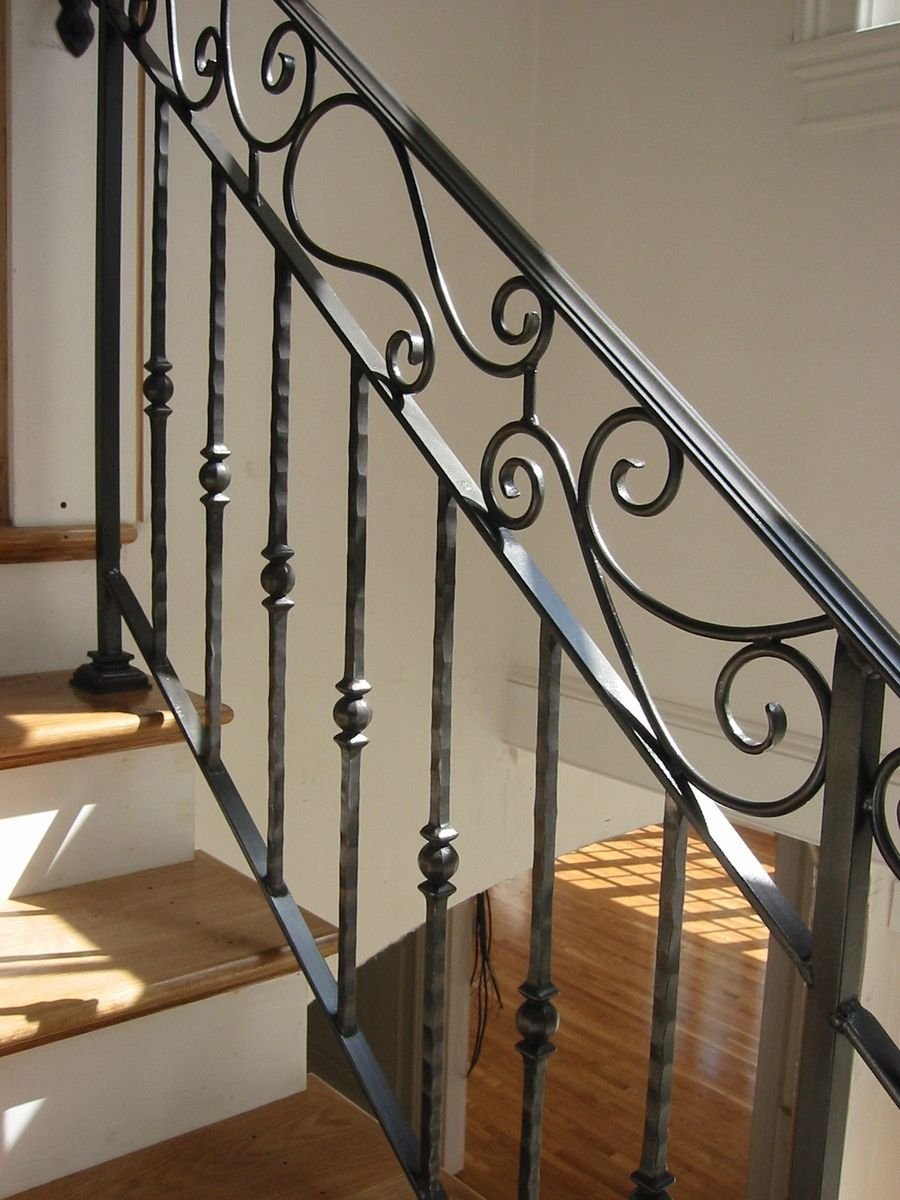Hand crafted custom interior wrought iron railing by for Interior iron railing designs