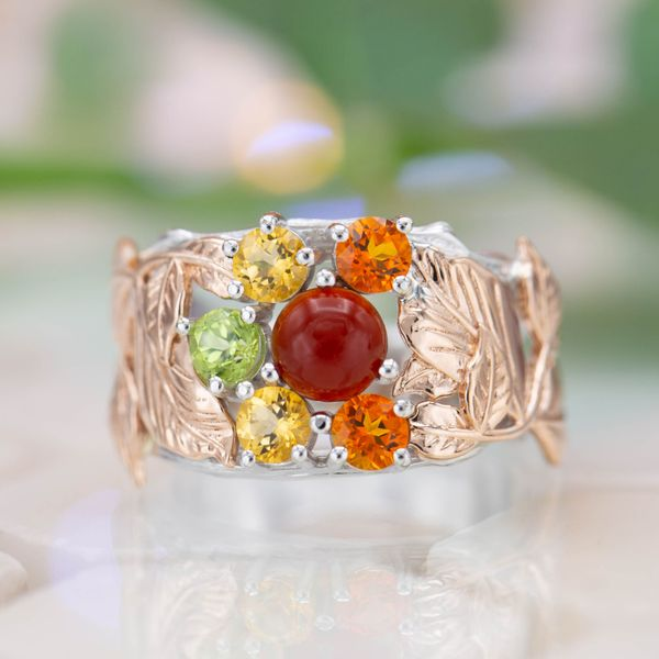 A bold, bohemian ring in mixed metals arranges multiple colors for an autumn-inspired gem cluster.