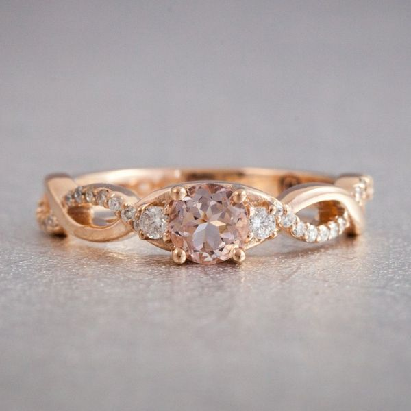 A low profile setting of a 5mm peachy pink morganite paired with twisting strands of diamond.