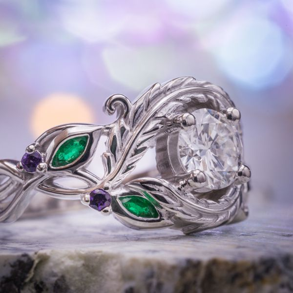 Bold (but airy) feather-and-leaf setting with emerald and amethyst accents.